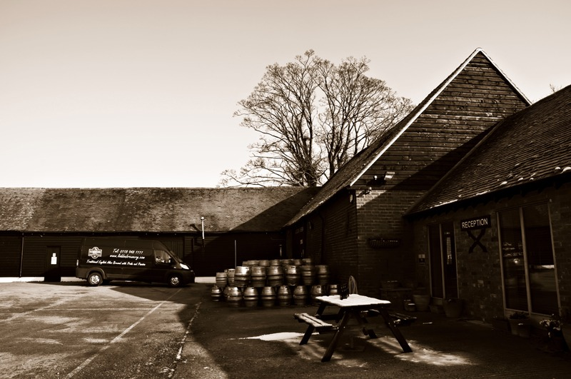 Yard of Loddon Brewery with car and barrels in sepia